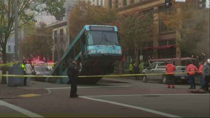 Bus falls into sinkhole in Pittsburgh