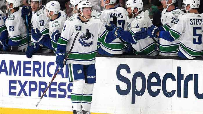 Boeser's third NHL hat trick