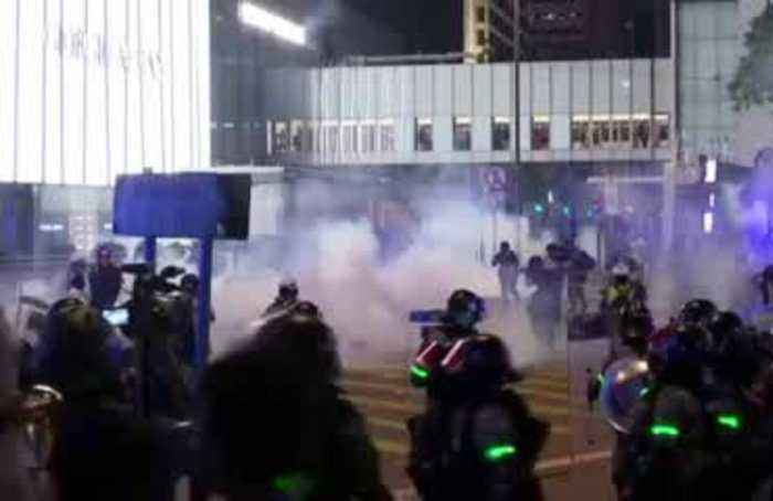 Hong Kong police fire tear gas to disperse Halloween protests