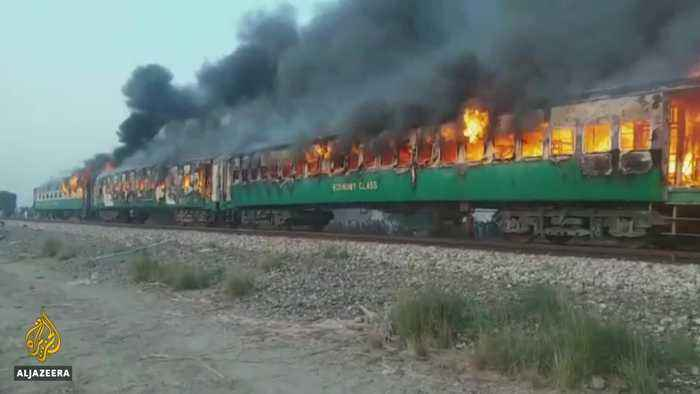 Funerals begin as town mourns victims of Pakistan train fire