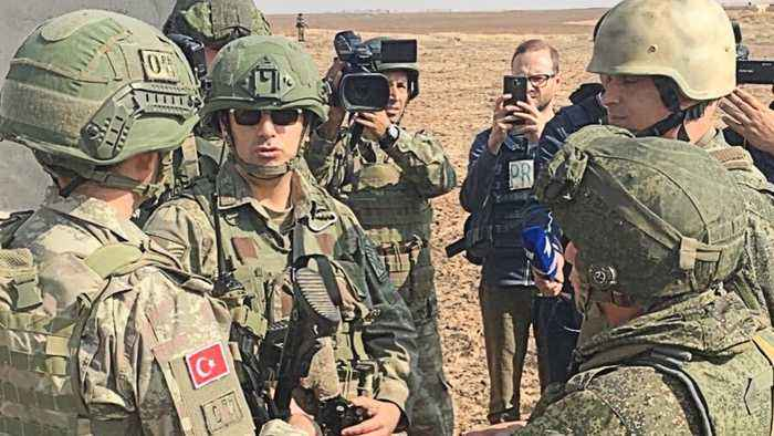 Russia and Turkey begin joint patrols in northeast Syria