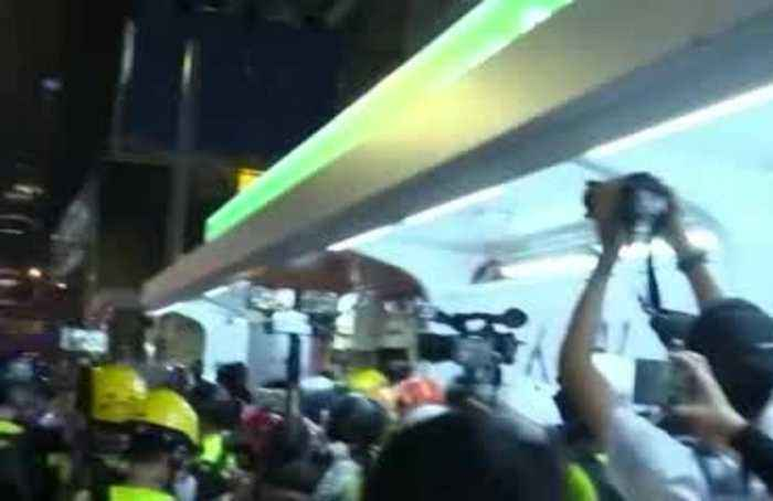 Hong Kong protesters set barricade on fire after police fire tear gas