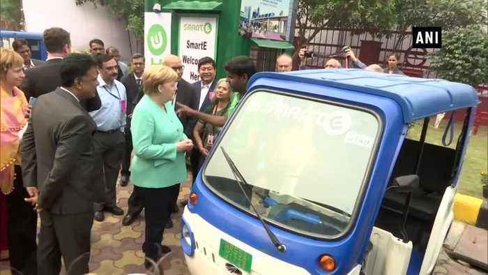 German Chancellor Angela Merkel meets e-rickshaw operators in Delhi