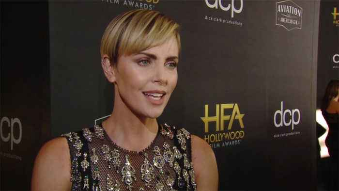Charlize Theron tearful after Nicole Kidman presents her with Hollywood Film Award