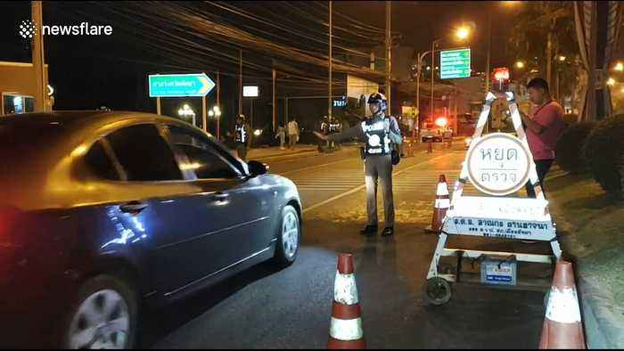 Police set up road blocks in hunt for American who escaped from prison in Thailand
