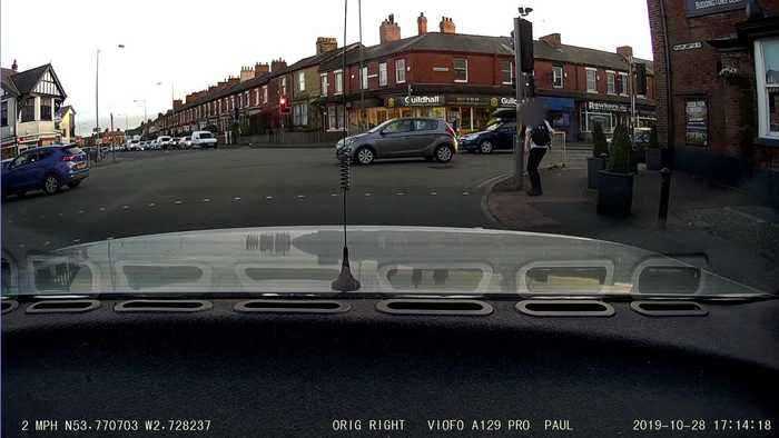 Watch hilarious moment driver catches student dancing in the street on car's dash cam