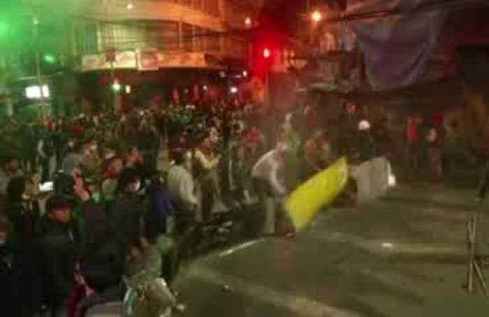 Tear gas streams through the streets of La Paz