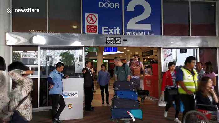 Tourist sparks panic after opening plane door moments before takeoff in Thailand