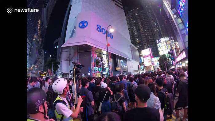 Hong Kong protestors hold vigil for dead comrade and police are responsible