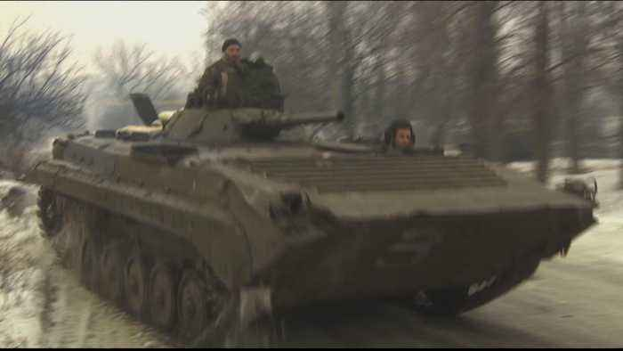 Ukraine troops, separatists withdraw amid hopes for peace