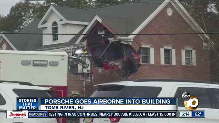 Porsche crashes into second floor of New Jersey office building