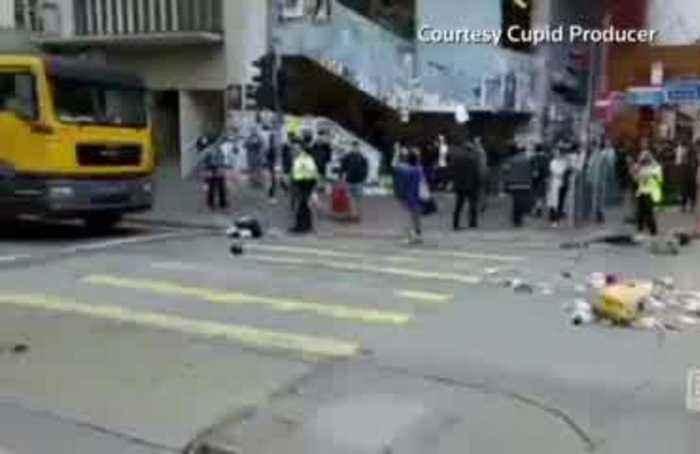 Hong Kong police shoot protesters