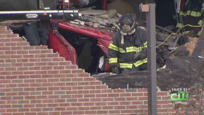 Two People Dead After Car Hits Median, Goes Airborne And Crashes Into Second Floor Of New Jersey Building