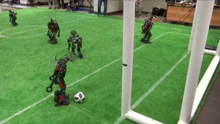 Battle Bots! Check Out These Robots Battling It Out On The Soccer Field!