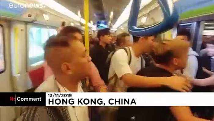 Arguments on train and Christmas tree alight as Hong Kong protests continue