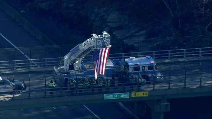 Firefighters, police salute procession for fallen firefighter
