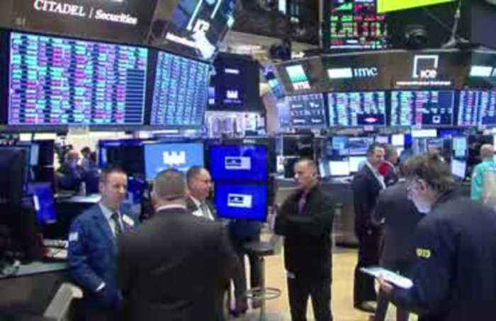 Fed chief, Disney send Dow, S&P 500 to records