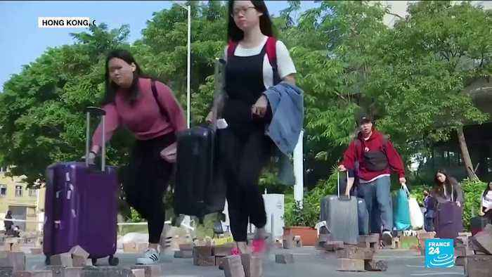 Feeling unsafe, students from mainland China flee Hong Kong