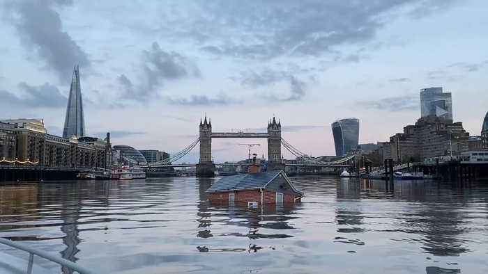 Extinction Rebellion Float 'Sinking House' In River Thames To Highlight Rising Sea Levels