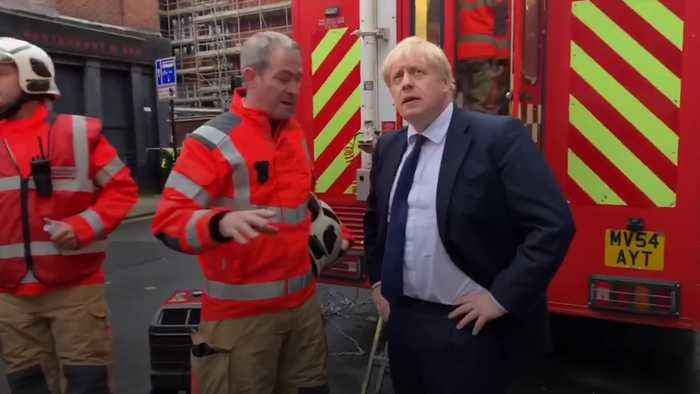 Boris Johnson meets firefighters and volunteers in Bolton after student block blaze