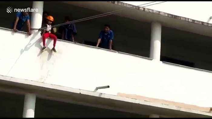 Terrifying moment a young girl falls 30 feet from zip line at Indian school
