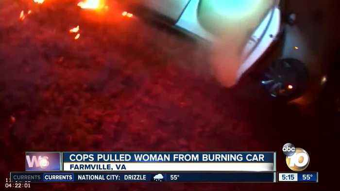 Virginia police officers pull woman from burning car