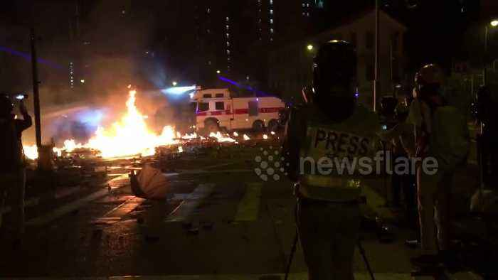 Clashes at Hong Kong Polytechnic University as police warn of lethal force