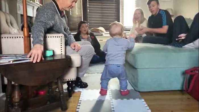 This is the heart-warming moment that a baby boy was filmed taking his first steps in footage that showcases his families' pri