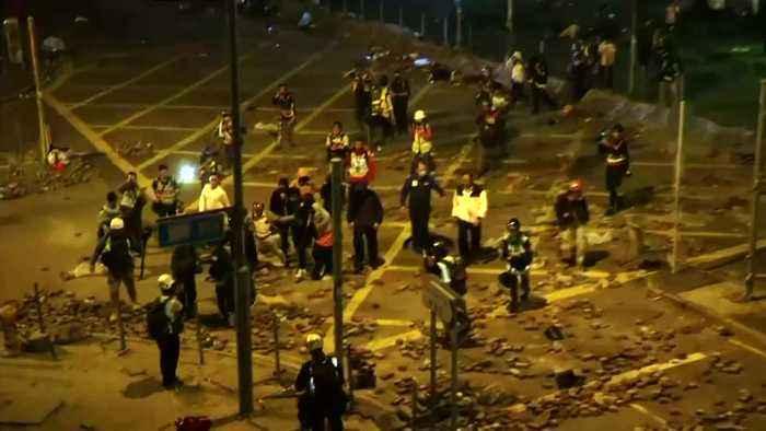 Students leave Hong Kong university siege