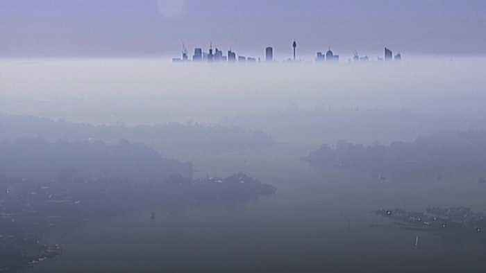 Smoke covers Sydney as wildfires continue to burn