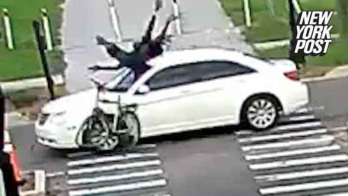 Car slams into cyclist and speeds off in dramatic hit-and-run