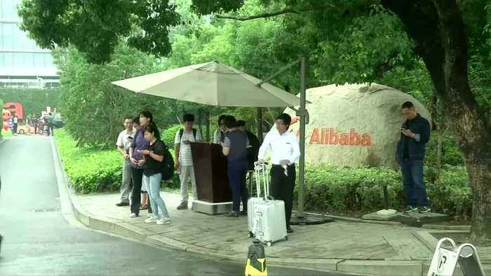 Alibaba raises up to $12.9 bln in HK listing