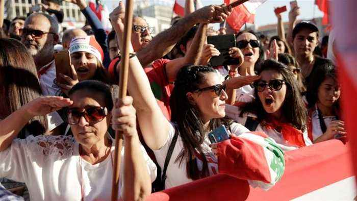 Defiant protesters hold rival parade on Lebanon independence day
