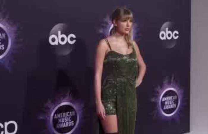 Music stars walk the red carpet at the American Music Awards
