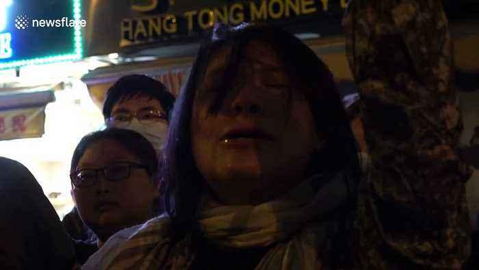 Protester cries as she chants outside Hong Kong's Polytechnic University