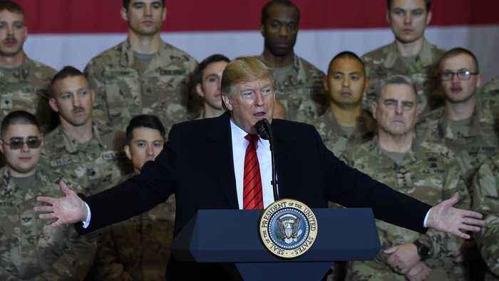 In surprise trip to Afghanistan, Trump says Taliban talks resumed