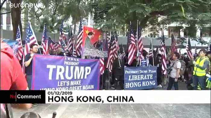 Hong Kong protesters hold US flags and praise Donald Trump