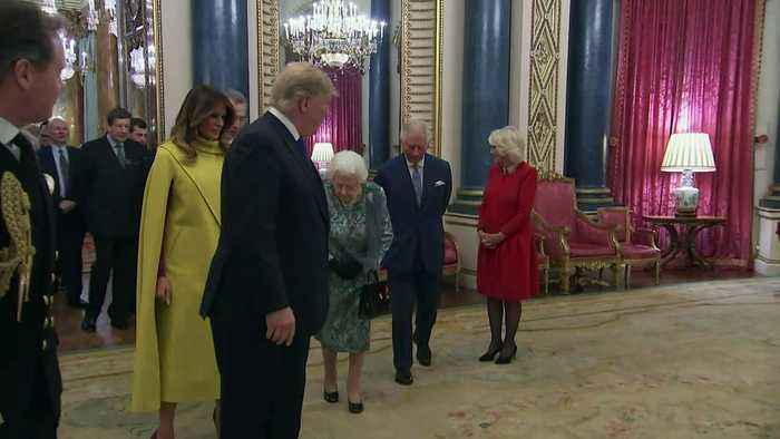 Queen greets Donald Trump and First Lady at Nato reception