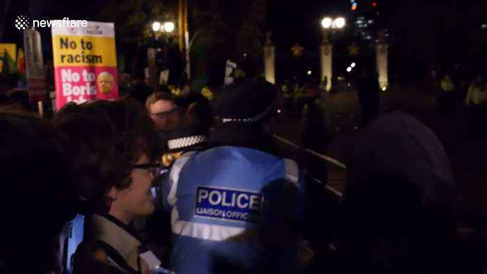 Angry anti-Trump protesters swear at police & tell US President 'go to hell'