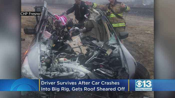 Driver Survives After Car Crashes Into Big Rig, Gets Roof Sheared Off