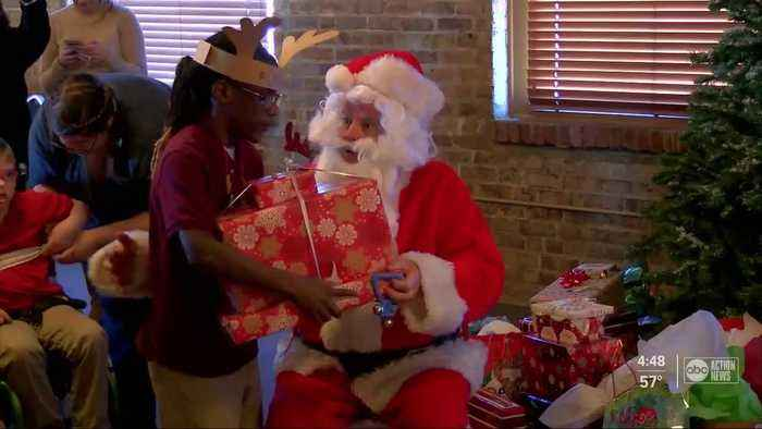Santa visits visually impaired students in Tampa, hands out gifts