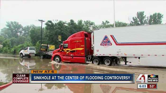 Sugar Creek wants to fine car lot owner along U.S. 24 for flooding issues