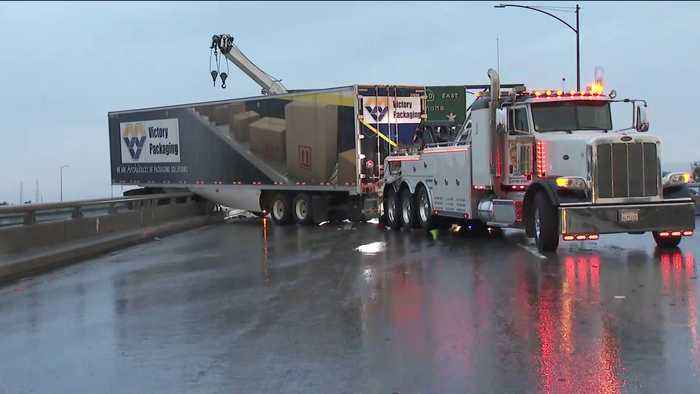Big Rig Hangs Over Side of Freeway Connector in East L.A.