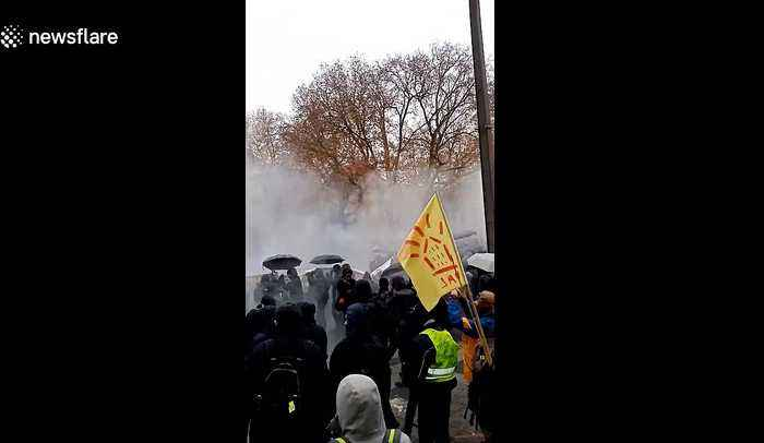 French police and protestors clash amid tear gas in Nantes