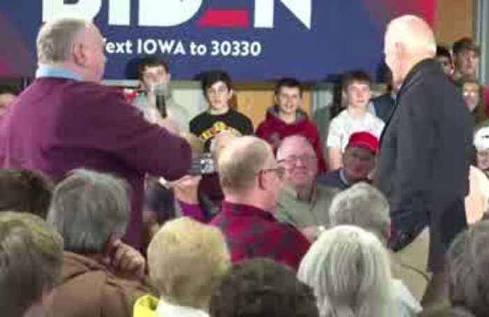 At Iowa event, Biden gets into spat over his son