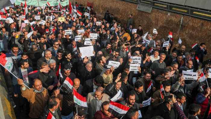 Tensions flare as unidentified gunmen kill protesters in Baghdad