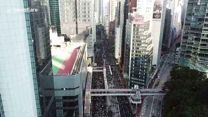 Drone footage shows thousands marching in Hong Kong