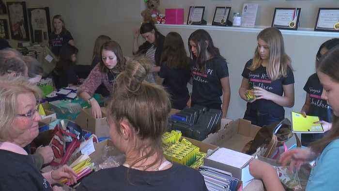 Volunteers Help 8th Grader Fill Hundreds Of Gift Bags For Homeless Children