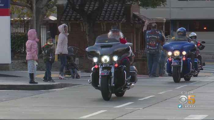 Santa Rides In On Harley To Deliver Toys To Kids At SF General Hospital