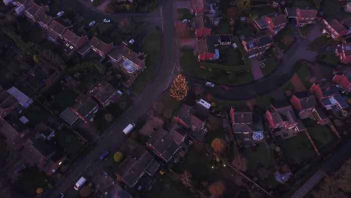 Britain's darkest village with no street lights becomes illuminated for Christmas after a couple decorate their old tree which g
